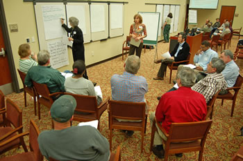 photo: several breakout groups at the Auburn public meeting