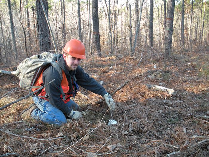 Ryan Sisk, Forestry Technician, installs fire probes for Callie's prescribed fire research.